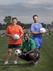 Three individuals involved in the Kaw Valley Soccer Association bring a variety of international experience to the Lawrence soccer scene. Representing three different continents, from left, are Riny de Boer, registrar and head coach of Kaw Valley Girls and All Girls academy director, who grew up in The Netherlands; Oumar Seck, coach of the Under-13 and Under-14 year-old boys, who spent his youth in Senegal, and Mauro Nobre, director of the organization's premier division and administrative manager of the Club League, who was born in Brazil.