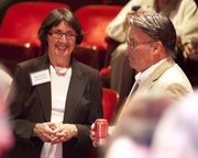 Lawrence Community Theatre Executive Director Mary Doveton talks with Mayor Mike Amyx at Wednesday's  reception.