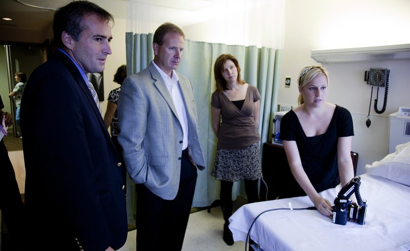 From left, Lawrence Police Chief Tarik Khatib, and Detective Capt. Mike Pattrick, along with Lawrence Memorial Sexual Assault Nurse Examiner Julie Jacobson watch Sarah Martin, also a SANE nurse, demonstrate a new imaging system used to collect evidence in sexual assault cases. LMH had a private open house Thursday, Sept. 9, 2010, for its SANE program.