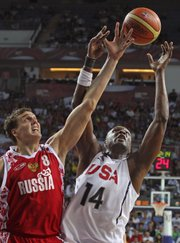Russia's Sasha Kaun, left, battles the United States' Lamar Odom for a rebound. Kaun came up with five rebounds to go with four points in Russia's 89-79 quarterfinal loss in the World Basketball Championship on Thursday in Istanbul, Turkey.