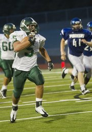Preston Schenck (5) returns a kickoff for a touchdown during Free State High School's matchup against Leavenworth Friday night.