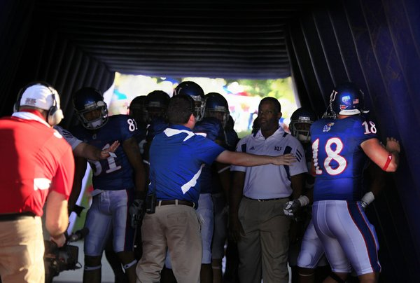 Turner Gill and the Kansas Jayhawks are held up inside an inflattable tunnel before taking the field against North Dakota State.