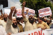Pakistani protesters rally Thursday in reaction to a small American church's plan to burn copies of the Quran in Multan, Pakistan. The plans are currently suspended.