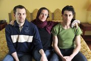 jailed Americans, from left, Shane Bauer, Sarah Shourd and Josh Fattal, sit at the Esteghlal Hotel in Tehran, Iran, in this May 20 file photo. Iran announced Thursday that Shourd, who has been jailed for more than a year, will be released Saturday to mark the end of the Islamic holy month of Ramadan.