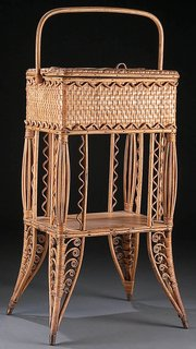 This woven wicker sewing basket was made around 1900 to be kept on the floor near a seamstress. It is 28 inches high. Although rare, it sold for only $75 at a Jackson's auction in Cedar Falls, Iowa.