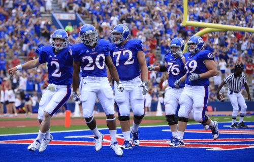 Kansas players Jordan Webb (2), D.J. Beshears (20) and Tanner Hawkinson (72) celebrate a touchdown by receiver Bradley McDougald against Georgia Tech during the first quarter, Saturday, Sept. 11, 2010 at Kivisto Field.