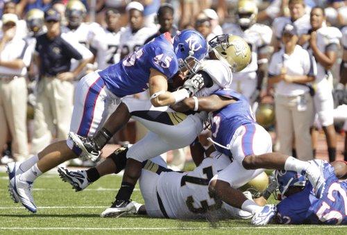 Kansas linebacker Justin Springer (45) takes Georgia Tech quarterback Joshua Nesbitt off his feet with a hard hit during the second quarter, Saturday, Sept. 11, 2010 at Kivisto Field.