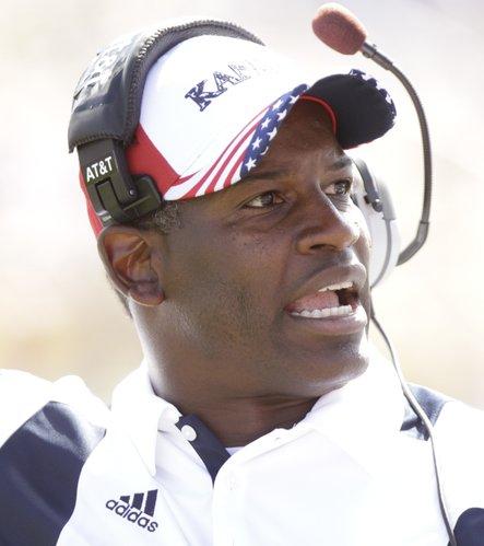 Kansas head coach Turner Gill calls a timeout against Georgia Tech during the second quarter, Saturday, Sept. 11, 2010 at Kivisto Field.