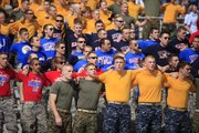Kansas ROTC members sing the Alma Mater prior to kickoff against Georgia Tech, Saturday, Sept. 11, 2010 at Kivisto Field. The Jayhawks won the game 28-25.
