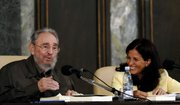 "Cuba's leader Fidel Castro, left, and Cuban journalist and biographer Katiuska Blanco, attend the presentation of Castro's new book ""La Contra Ofensiva Estrategica,"" or ""The Strategic Counter Offensive,"" Friday at the University of Havana."