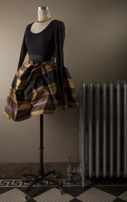 "Hobbs Inc. clothing for the Douglas County Medical Alliance fashion benefit include this plaid ruffle ""Friday"" skirt by Vivienne Westwood ""Anglomania"" with a black V-neck T-shirt."