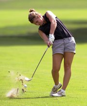 Lawrence high senior golfer Kathryn Lunte blasts a drive at the Free State Invitational on Monday at Lawrence Country Club.