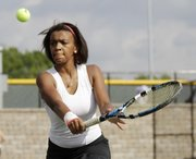 Lawrence High junior Taylor Eubanks prepares to return a volley in a doubles match against Topeka High on Monday at the Lawrence Tennis Center.
