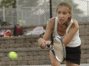 Lawrence Lions #1 singles player Morgan Manger competes against a Topeka High opponent in a quad match.