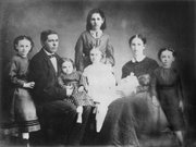 The Patrick Mungan family was among those who survived Quantrill's Raid in 1863. Patrick, a lime burner and builder, saw business opportunities in Kansas City and moved there, but his older daughter, Katie (standing in back) maintained her Lawrence allegiances and attended raid survivor reunions in 1913 and 1925.