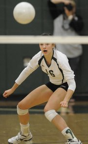 Sophomore Shelby Holmes watches as the ball returns to her side on the outside line as Free State went against Shawnee Mission Northwest in volleyball quad action Thursday, Sept. 16, 2010.