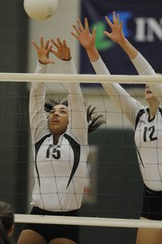 Junior Brie Mingus, left, and senior Meaghan Holmes get a block together as Free State competes against Shawnee Mission Northwest in volleyball quad action Thursday, Sept. 16, 2010.