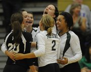 The Firebirds cheer together after scoring against the Cougars as Free State went against Shawnee Mission Northwest in volleyball quad action Thursday, Sept. 16, 2010.