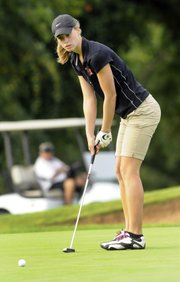 Lawrence High golfer Taylor Covert watches her putt Thursday at Alvamar.