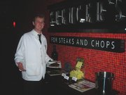 A waiter serves an Omaha steak at Spencer's for Steaks and Chops.