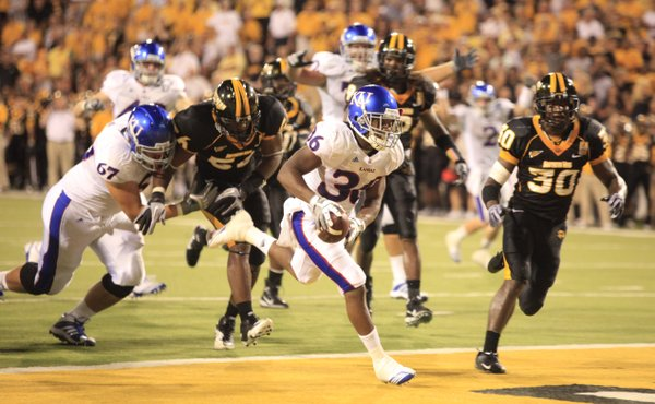 An excited Kansas running back Deshaun Sands scampers in for a touchdown against Southern Miss during the third quarter, Friday, Sept. 17, 2010 at M.M. Roberts Stadium in Hattiesburg, Mississippi.