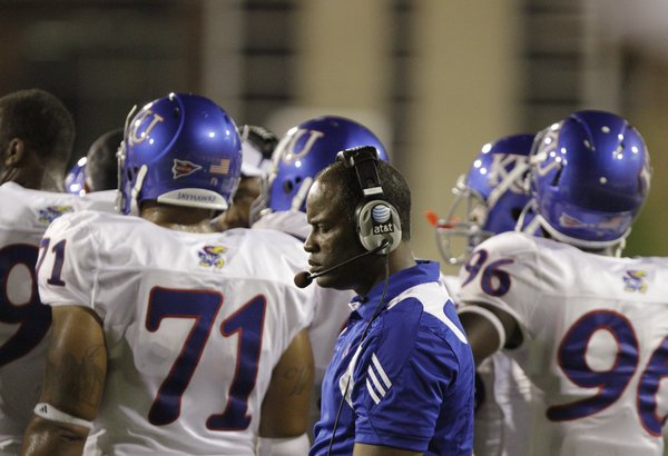 Kansas head coach Turner Gill closes his eyes as he paces past his players during the fourth quarter against Southern Miss, Friday, Sept. 17, 2010 at M.M. Roberts Stadium in Hattiesburg, Mississippi. The Jayhawks fell to the Golden Eagles 31-16.