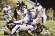 A heap of Kansas defenders pile on top of Southern Miss running back Desmond Johnson during the third quarter, Friday, Sept. 17, 2010 at M.M. Roberts Stadium in Hattiesburg, Mississippi. The Jayhawks fell to the Golden Eagles 31-16.