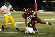 Lawrence High running back Charles Jackson evades a tackle Friday evening against Shawnee Mission South. Jackson scored one touchdown in the Lions 28-7 victory.