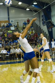 Kansas University outside hitter Karina Garlington makes an over-the-back save against Texas A&M. The Jayhawks won the match, 3-2, on Saturday at Horejsi Center. The victory was KU coach Ray Bechard's 200th at Kansas.