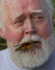 Monarch watch director Chip Taylor holds a butterfly gently in his mouth while conducting a brief class Sept. 18, 2010, at a monarch tagging event in the Baker Wetlands.