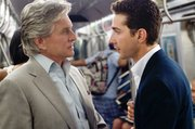 "Michael Douglas portrays Gordon Gekko, left, and Shia LaBeouf portrays Jake Moore in a scene from ""Wall Street: Money Never Sleeps."""