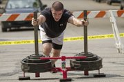 Matthew Andre, Lawrence, pushes the prowler sled with 340-pounds on top Saturday at the second annual Lawrence Next Level Games strongman competition at Watson Park.