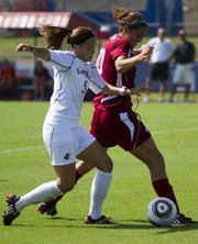 Kansas University forward Kortney Clifton (5) fights for control of the ball against Missouri State defender Jordan Reppell. Clifton scored both goals in a 2-0 victory Sunday at the Jayhawk Soccer Complex. Story on page 3B.