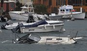 A boat is swamped with water at Flatts Inlet in Smith's parish while Hurricane Igor passes near Bermuda on  Sunday.