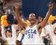 UCLA's Ed O'Bannon celebrates after his team won the NCAA championship against Arkansas in this April 3, 1995, file photo. O'Bannon and former football quarterback Sam Keller are seeking to radically alter the NCAA's multibillion dollar business model by leading a legal challenge that seeks a significant revenue share for amateur athletes.