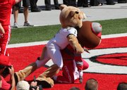 In this handout provided by OhioCollegeFootball.com, the Ohio University mascot, left, takes Ohio State mascot Brutus down to the ground before the start of Saturday's game in Columbus, Ohio.