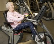 Mike Yoder/Journal-World Photo.Dorothy McGregor, 91, works out every day at the Lawrence Athletic Center. Rotating through one of several exercise stations McGregor uses a recumbent stationary bike while watching the news Wednesday, Sept. 21, 2001,