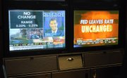 Two television networks, seen Tuesday in the Goldman Sachs cubicle on the floor of the New York Stock Exchange, broadcast the news that the Federal Reserve had left rates unchanged in their final meeting before the mid-term elections.