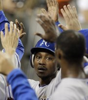 Kansas City's Jarrod Dyson is congratulated after scoring on a Mike Aviles single in the fifth inning.
