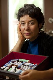 JoAnn Farb is pictured with a drawer of various homeopathic remedies Thursday at her home. Farb became a believer in homeopathic remedies about 15 years ago when she sought the help of a homeopath in Australia for help with her daughter Sarina's eczema.