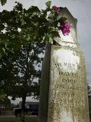 A large monument marks the grave of Henry T. Davis, who died in 1892, long before becoming the namesake of Henry T's Bar and Grill, 3520 W. Sixth St. Davis had a farm on the property where the restaurant sits today.