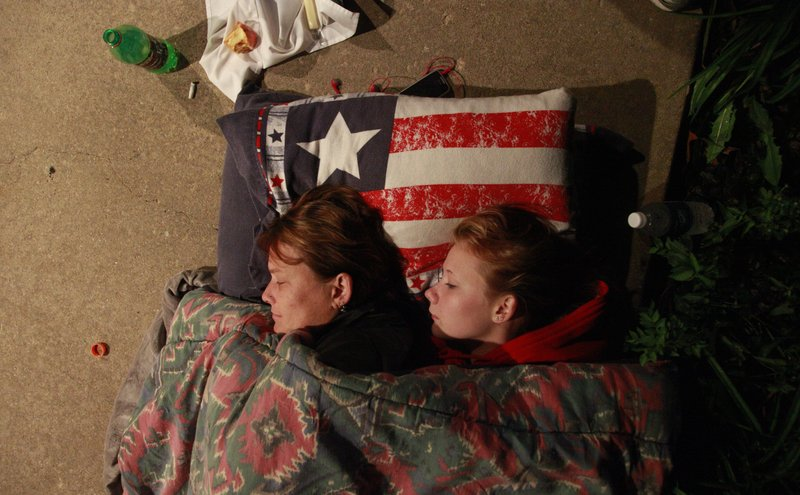 Debbie Souders 38,  and her daughter Brandie Roberts 19, try to sleep at 4:30 a.m. Friday, Sept. 24, 2010