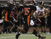 Late in the fourth quarter, wide receiver Anthony Buffalomeat (18) gets a reception for big yardage as Lawrence went against Shawnee Mission Northwest Friday, Sept. 24, 2010 in Overland Park. Lawrence came up short losing 20-23.
