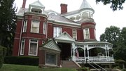 The Muchnic Gallery is housed in a three-story brick Queen Anne property on Fourth Street, Atchison