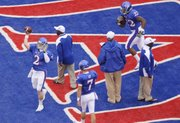 Kansas quarterback Jordan Webb warms up before kickoff against New Mexico State Friday, Sept. 25, 2010 at Kivisto Field.