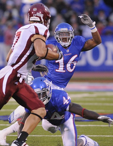Kansas defenders Chris Harris (16) and Olaitan Oguntodu (44) collapse on New Mexico State tight end Kyle Nelson (17) during the first quarter Friday, Sept. 25, 2010 at Kivisto Field.