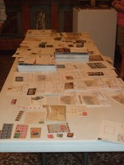 Stamps for auction are set up at the Sept. 2 Lawrence Stamp Club meeting.