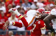 Chiefs quarterback Matt Cassel (7) lifts wide receiver Dwayne Bowe after a second-half touchdown. Cassel threw three TDs Sunday.