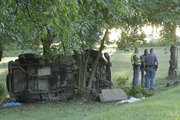 A Jeep came to rest against some trees after a single-vehicle rollover accident between Lawrence and Lecompton. The accident was reported near E 758 Road and N 1800 Road about 6 p.m. Sept. 28, 2010.