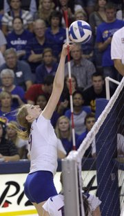 Kansas University's Caroline Jarmoc delivers a return across the net for a point against Missouri. The Jayhawks beat the Tigers, 3-1, on Wednesday at Horejsi Center.